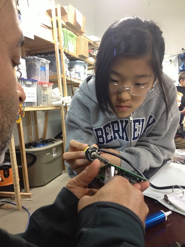 Image of Natalie and a mentor soldering courtesy of Mr. Lim.